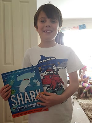 Alfie Gordon with Shark Super Powers book
